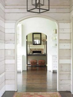 arches and horizontal wood plank walls