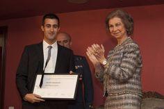 Queen Sofia congratulates the young winning composer Joan Magrané Figuera.