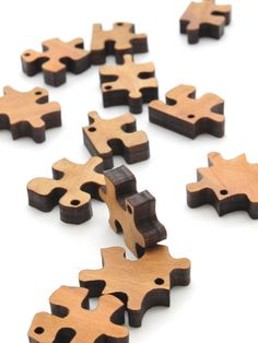 Mini Puzzle Piece Beads - Laser Cut Wood - Free Shipping - Etsy Itsies by Timber Green Woods. $3.95, via Etsy.