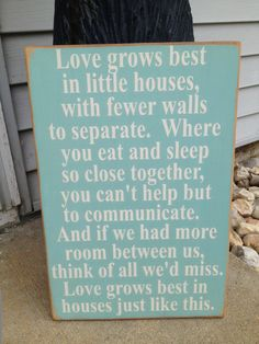 Love the color of this wooden wall quote and it's so true. Love grows best in little houses!