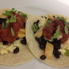 Try these Breakfast Tacos for dinner! Layer corn tortillas with scrambled eggs (I used 1 whole egg and 2-3 egg whites per person), black beans, reduced-fat cheese, salsa, and optional cilantro. What would you add?