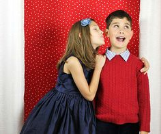 Hang fabric or curtain panels for an instant holiday photo booth for family snapshots. For extra fun, add printable props related to the specific holiday, like antler ears and Santa hats for Christmas.