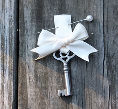Key boutonniere for the Groom, the Bride can have the Heart locket on her bouquet <3 - 'Key to my Heart.'