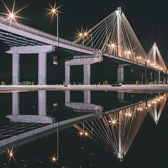 Trashhand had another take on the Clark Bridge at night. #Reflection @Visit Alton