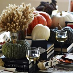 Invite friends over for a Tale of Horror Halloween Party. Learn more here: http://www.bhg.com/halloween/parties/halloween-theme-parties/#page=7 holiday, halloween parties, halloween decor, black books, fall table, decorating ideas, pumpkins, tabl decor, centerpieces