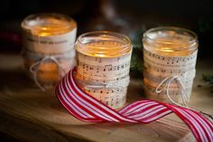 Sheet music wrapped around votive candles; warm & cozy