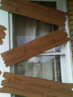 Use cardboard and brown paint to make faux boards to board up windows for Halloween