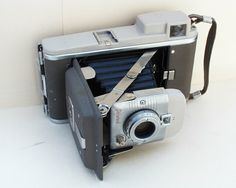 A copy of Mary Ann Moorman's Polaroid HIghlander 80a camera.