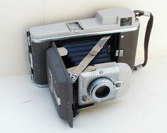 A copy of Mary Ann Moorman's Polaroid HIghlander 80a camera.