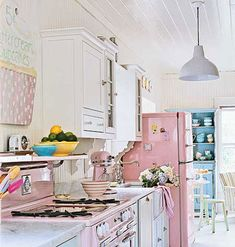 Custom-painted appliances and two-tone cabinetry give this kitchen a look as delicious as a sweet dessert. Myhomeideas.com
