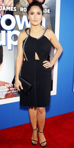 At the Grown Ups 2 premiere, Salma Hayek flashed a peek of skin in a Saint Laurent cut-out LBD with sparkly silver straps. She accessorized with strappy black stilettos and Gaydamak jewelry.