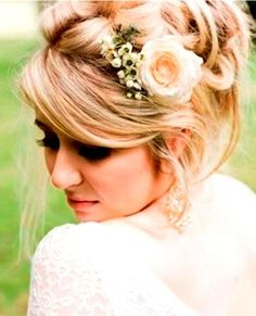 Bride's side part casual looped updo bridal hair ideas Toni Kami Wedding Hairstyles ♥ ❶ with flowers wedding hairstyle