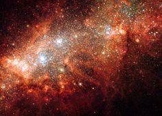 Supernova blast bonanza in nearby galaxy   ESA/Hubble