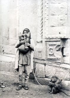Bagpipe player with a monkey, Aleppo, Syria, circa 1920
