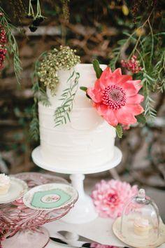 flower topped cake, photo by Megan Welker Photography http://ruffledblog.com/garden-romance-wedding-inspiration #weddingcake #cakes