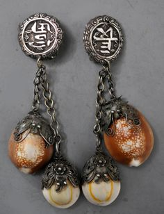 Chinese tops with Mongolian tassels of mounted shells (design and private collection Linda Pastorino)