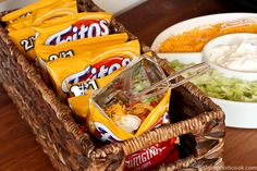 Introducing: Walking Tacos. For a casual party feeding lots of people, set up a bar with bags of Fritos and condiments such as cheese, lettuce, sour cream, and pico de gallo for guests to toss in their own bag. | unsophisticook.com