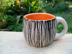Small White and Orange Ceramic Mug with Black Pinstripes, via Etsy.