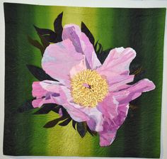 """""""Enticement"""" by Joan Bratton, 2013 Fine Art of Fiber exhibit.  Began with a photo of a peony in my garden; inspired by Melinda Bula. Machine quilted, hand dyed and commercial cottons, silks."""