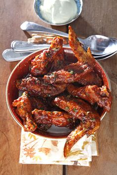 Chipotle Wings-- Found in most supermarkets and Mexican grocers, canned chipotles in adobo make a smoky, fiery sauce for chicken wings. Serve the wings with avocado crema.