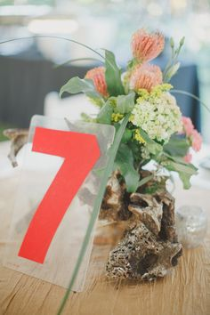gas station numbers as table numbers, photo by By the Robinsons http://ruffledblog.com/sunken-gardens-florida-wedding #weddingideas #tablenumbers