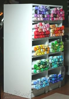 Copics in a tabletop cubby storage system via Sharon Harnist.