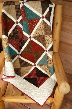 Simple hourglass Late Bloomers quilt. Love this photo.