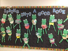 "These frogs holding books in their arm for this ""Spring Into a Good Book!"" were created by Grade 2 students.  This is a fun and eye catching spring bulletin board display idea."