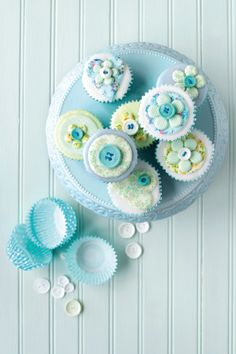 Charmingly lovely button topped blue cupcakes.