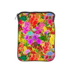 Colorful Floral Pattern iPad Sleeve  A very colorful, pretty floral image featuring a flower pattern of pink, red, yellow and green flower...