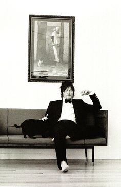 Or totally chill hangouts with his BFF. | These Photos Of Norman Reedus With His Black Cat Are Badass
