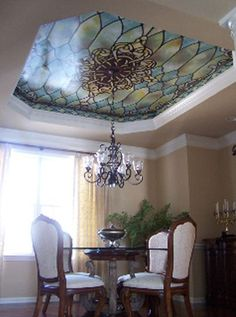 Stained glass mural above the dinner table... Or the bathtub would be cool