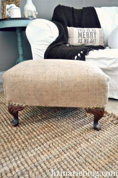 ❥ DIY ::  Ten Dollar Burlap Ottoman. Love the pillow and cant believe she got such low prices on upholstery tacks.