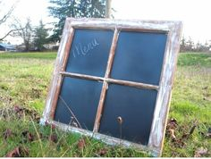 Neat sign: old window, chalkboard paint.  Looks like it might fit in well to a barn wedding.