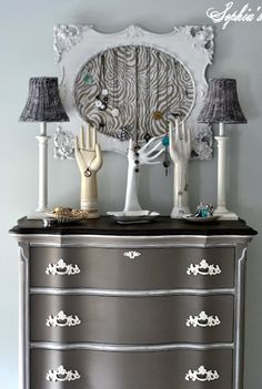 painted the dresser out in Coco, spray-painted the handles a creamy ivory and gave the dresser a white glaze wash