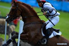 Yoshiaki Oiwa of Japan competes during the cross-country match of equestrian event at London 2012 Olympic Games, London, Britain, July 30, 2012. (Xinhua/Gaesang Dawa)