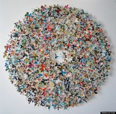 Rebecca Cole's paper sculptures. That is a lot of paper butterflies.