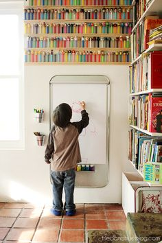 Use a few unrelated supplies to create the perfect art center for your kids! Includes material list and suggestions where to find them. #kidsroom #art