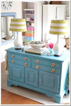 Brown dresser made into a fun and colorful sofa table