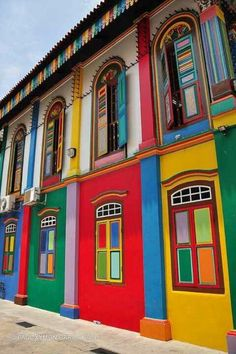 Vividly painted shophouses in Little India, Singapore.