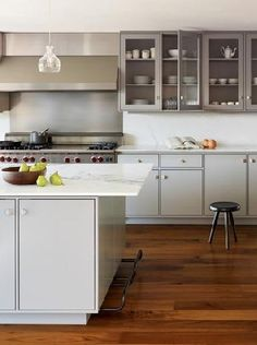 steel upper cabinets, custom cabinetry, pendant lights, white cabinets, white kitchens