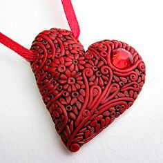 how to make this clay filigree heart colors and all - interesting technique. Could create stamps to make all the small elements rather than roll them all out by hand.