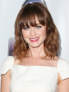 Blunt bangs, beachy waves, and ombré color make Alexis Bledel's shoulder-grazing crop far from dull. See our favorite celebrity lob haircuts here: