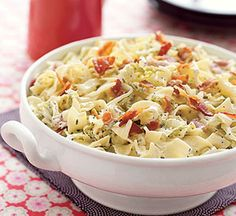 This hot vegetable recipe combines some unlikely ingredients--cabbage, bacon, onion, egg noodles, and sour cream--into a delicious side dish in less than 30 minutes.