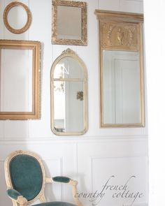 Gallery wall of mirrors and frames