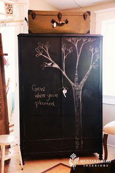 Tree painted on black armoire