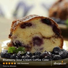 Blueberry Sour Cream Coffee Cake | Watch how to make a dense, moist blueberry sour cream coffee cake with a scrumptious cinnamon, brown sugar, and pecan filling. It's delicious with either fresh or frozen blueberries. Repin for your next Sunday brunch!