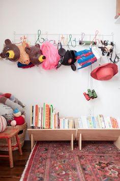 Bookshelf Ideas for Kids' Rooms // low-lying wooden shelves via jordan ferney kids bookshelf ideas, bookshelf for kids, book storage, kid rooms, bookshelf kids, dress up, bedroom for 3 kids, children books, little playroom