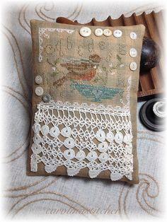 sweet bird cross stitch pillow ornament with pretty lace trim