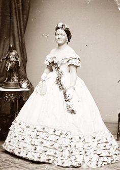 Mary Lincoln wearing one of her majestic gowns. She was known to love to wear flowers in her hair - this portrait illustrates that clearly.